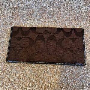 Coach: brown jacquard fabric checkbook cover